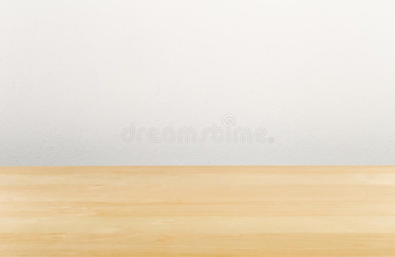 Brown wooden empty office desk with white wall stock images