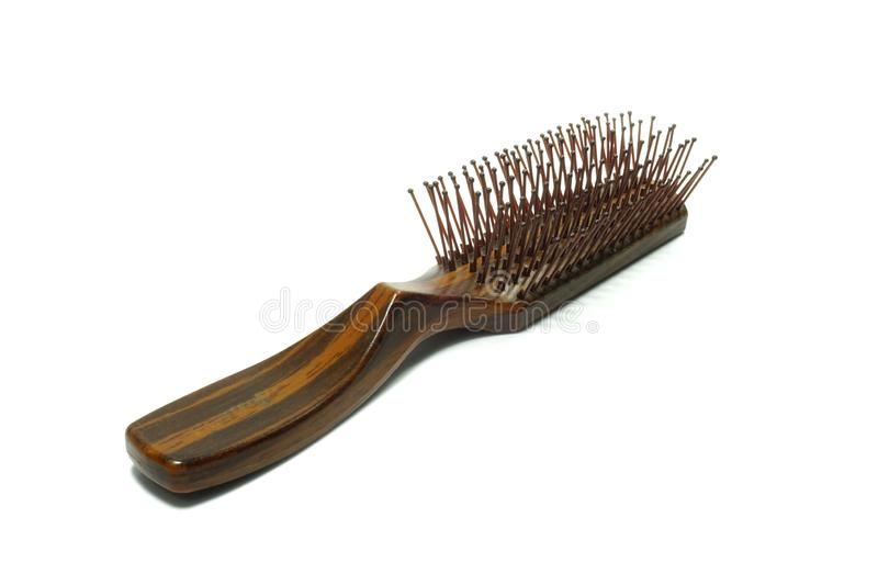 Brown wooden handle comb iso lated. Brown wooden handle comb iso lated on white background stock photo