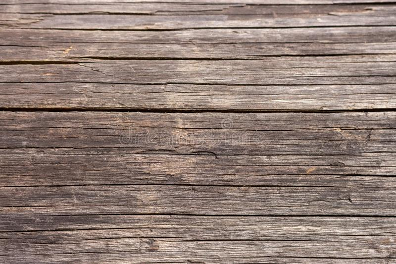 Brown wooden horizontal planks. Aged grunge wooden panels. Organic wall decoration. Hardwood boards. stock photos