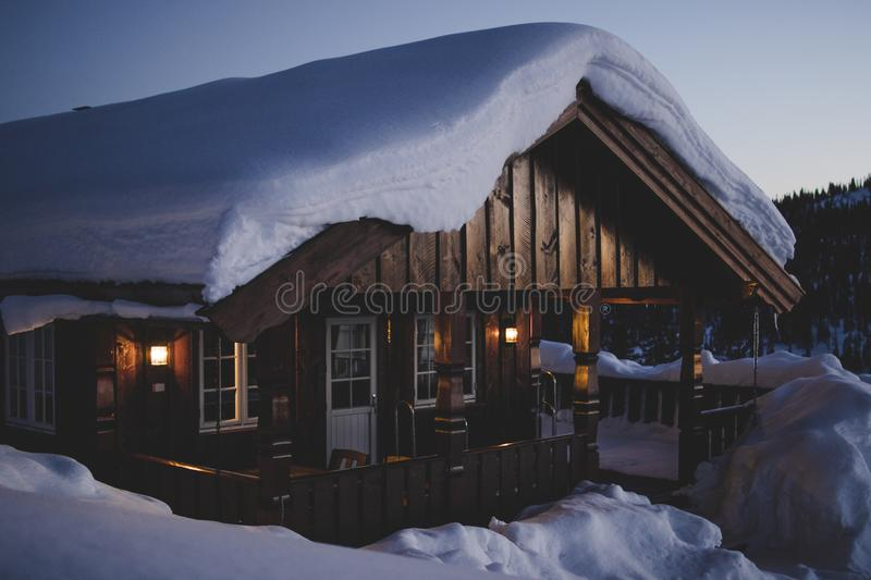 Brown Wooden House during Snow royalty free stock image