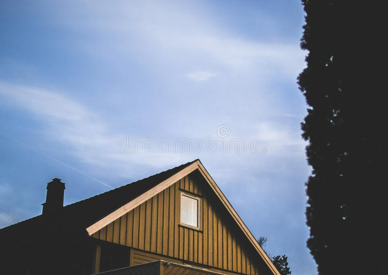 Brown Wooden House Under Blue Sky at Daytime stock photos