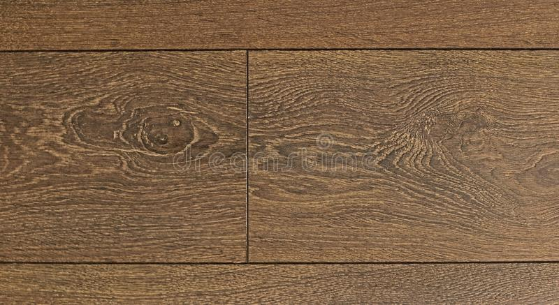 Brown wooden parquet texture. With several scratches royalty free stock photos