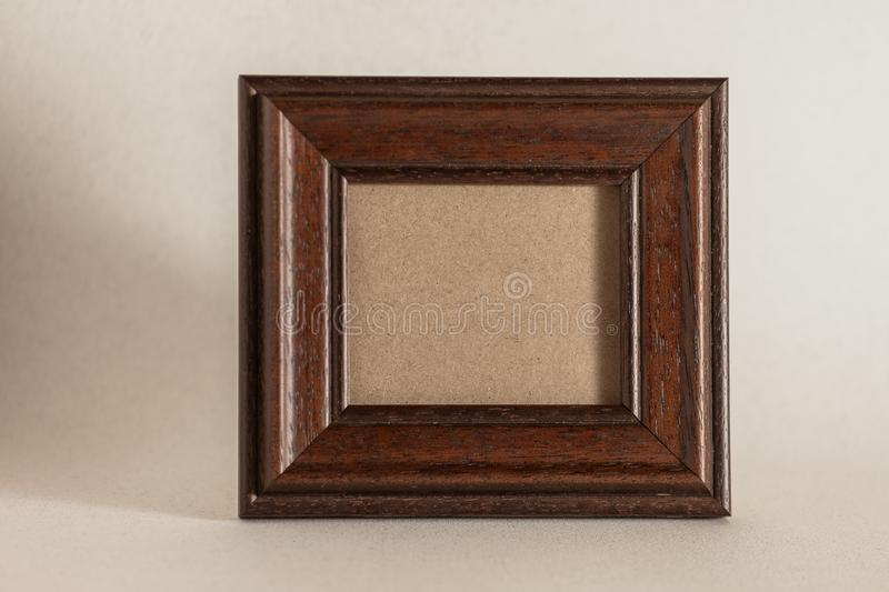 Brown wooden photo frame stock images