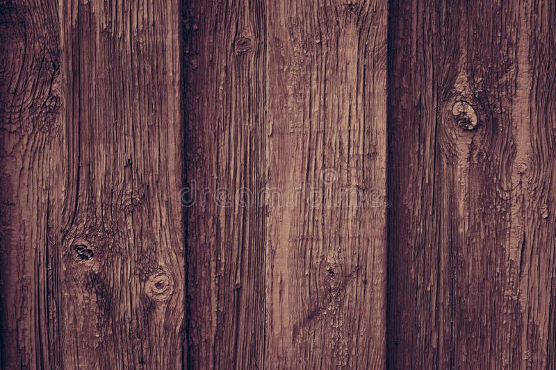 Brown wooden retro table. Red wooden wall background in rustic style. Old brown wall wood vintage floor. Wooden fence maroon paint royalty free stock images