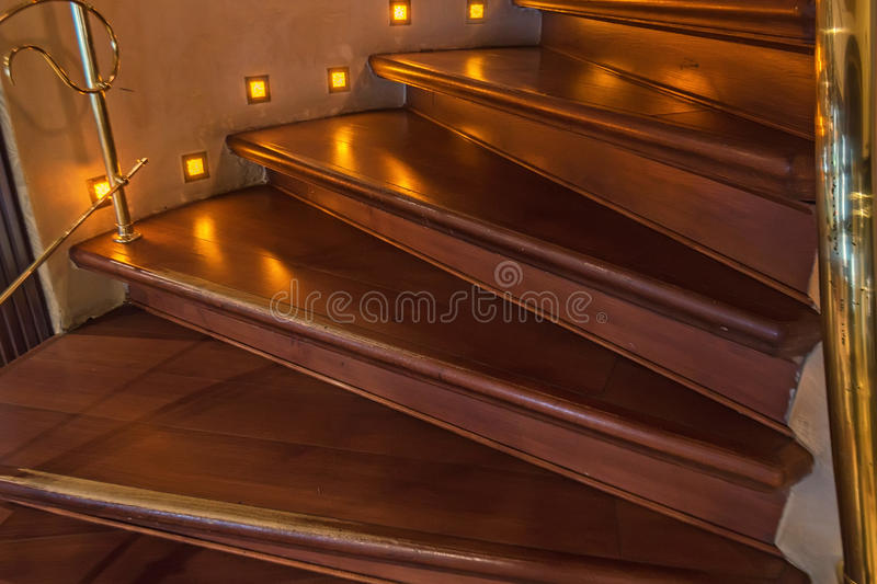 Brown wooden staircase. With banister in modern house stock image