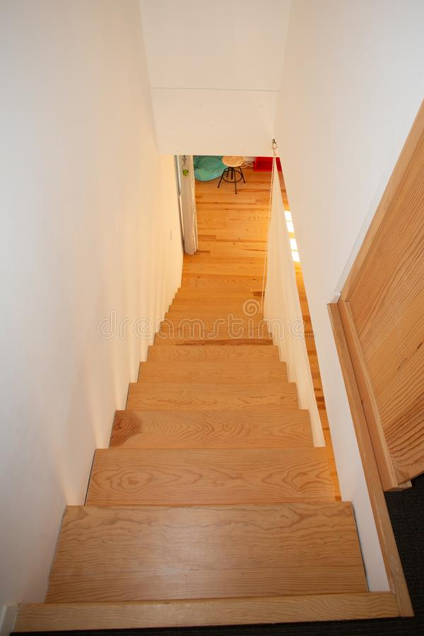 Brown wooden staircase in the modern house. A brown wooden staircase in the modern house stock photo