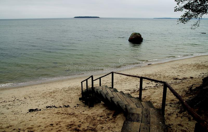 Brown Wooden Stairs Near Body of Water royalty free stock photo