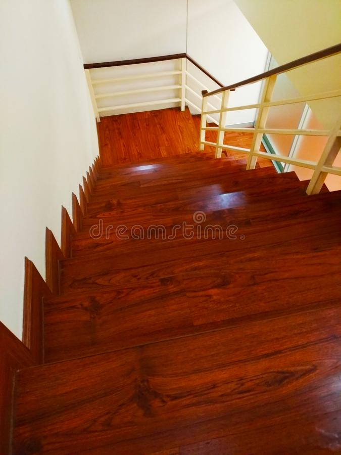 Brown wooden stairs at the office. royalty free stock photo