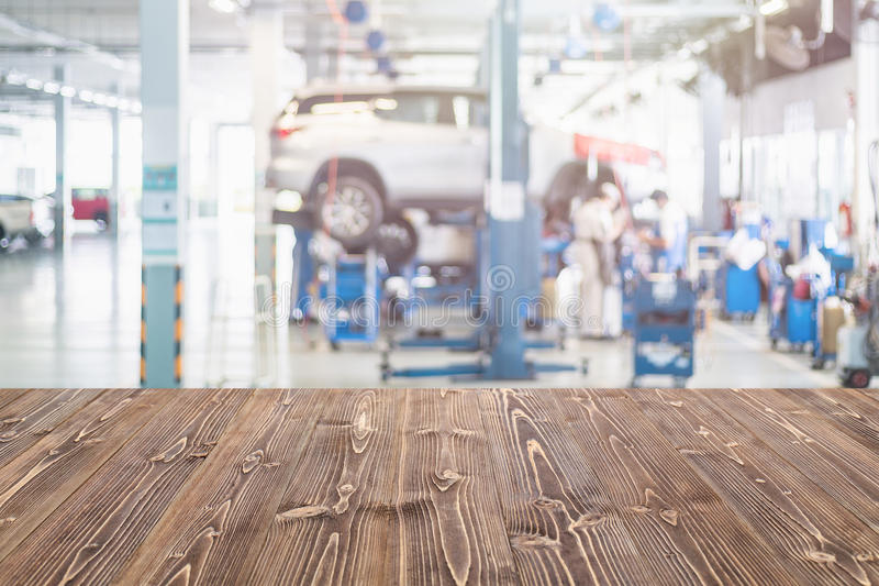 Brown wooden table free space and blurred background of car tech stock image