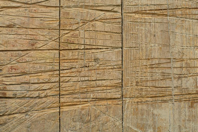 Brown wooden texture with deep vertical scratches royalty free stock image