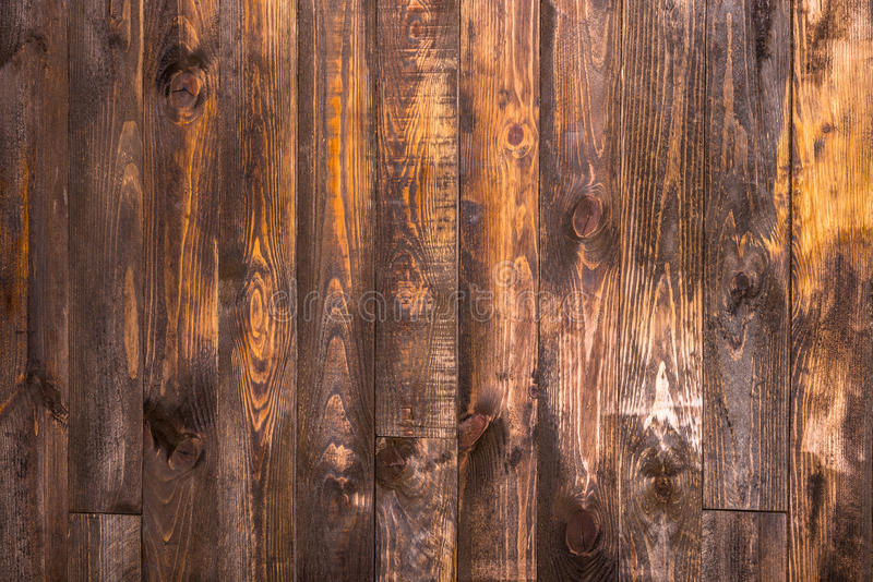Brown wooden vertical boards. Texture for the background. Horizontal frame. Brown wooden vertical boards. Texture for the background royalty free stock photo