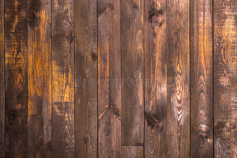 Brown wooden vertical boards. Texture for the background. Horizontal frame. Brown wooden vertical boards. Texture for the background stock photo