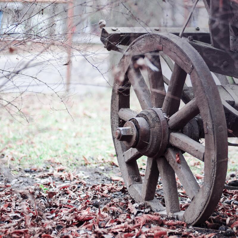 Brown Wooden Wheel on Land during Daytime royalty free stock images