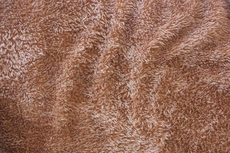 Brown wool texture from a piece of crumpled clothes. Brown background wool fabric from a piece of crumpled clothes stock photos