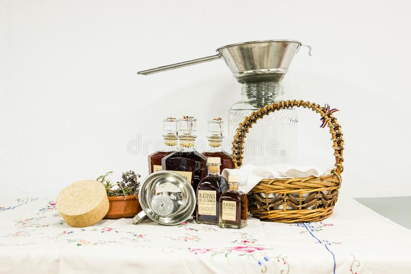 Brown Woven Basket Beside Clear Bottle on White Table Clothe stock image