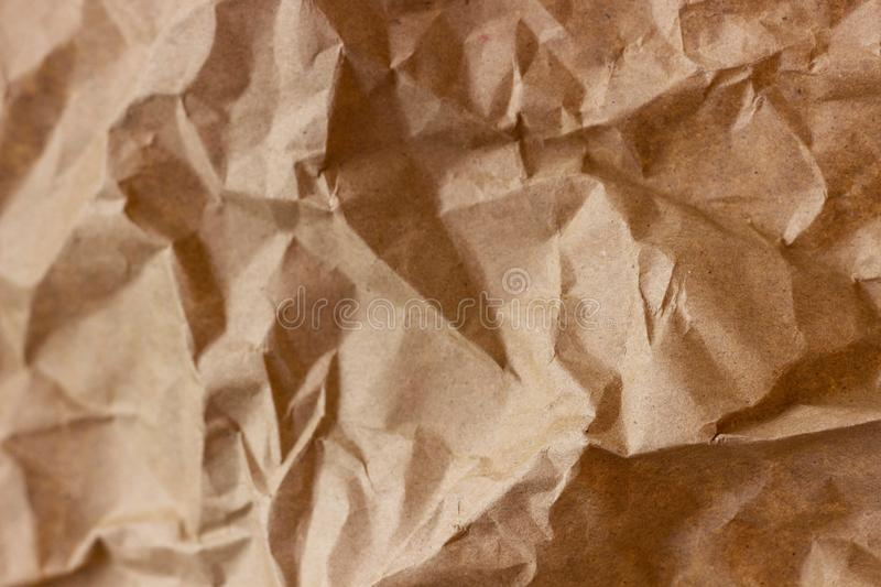 Brown wrinkle recycle paper background. Texture of crumpled paper. Texture of rumpled old paper close-up royalty free stock images