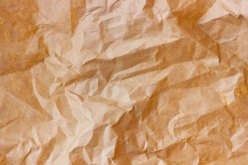 Brown wrinkle recycle paper background. Texture of crumpled paper. Texture of rumpled old paper close-up stock images