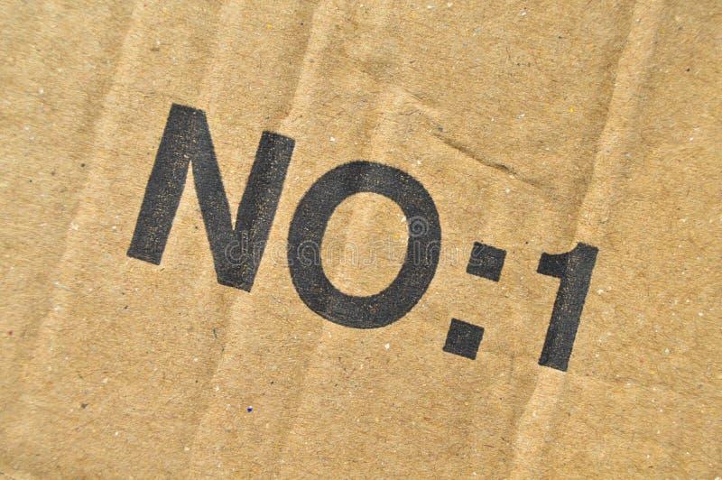 Brown y cartulina acanalada coloreada beige, número uno, no: 1 imágenes de archivo libres de regalías