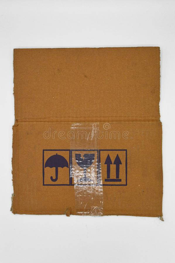 Brown y cartulina acanalada coloreada beige, señales de peligro fotografía de archivo