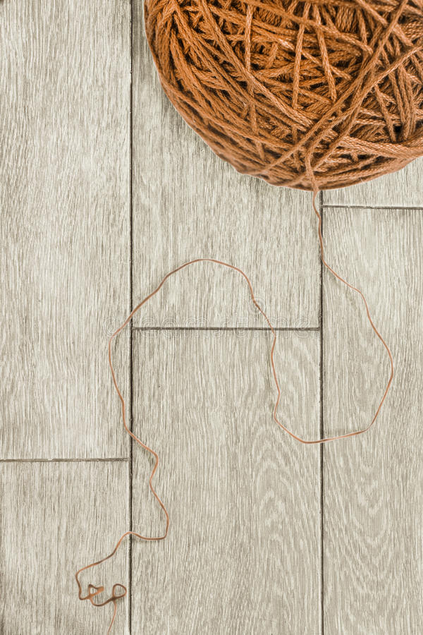 Brown yarn. On wooden floor as a background stock photo