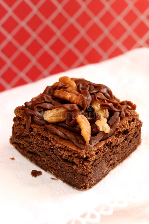 Brownie. Fudge brownie with frosting and nuts stock images