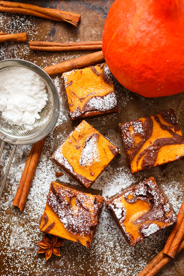 Brownie. Chocolate brownies with pumpkin and cinnamon. A traditional American dessert royalty free stock photography