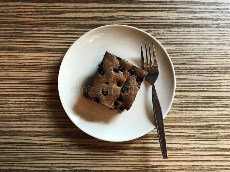 Brownie coberta com navio do chocolate fotografia de stock