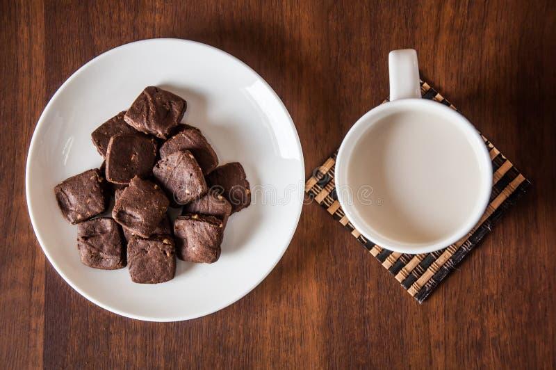 Brownie cookie milk. Brownie cookie and milk cup royalty free stock photos
