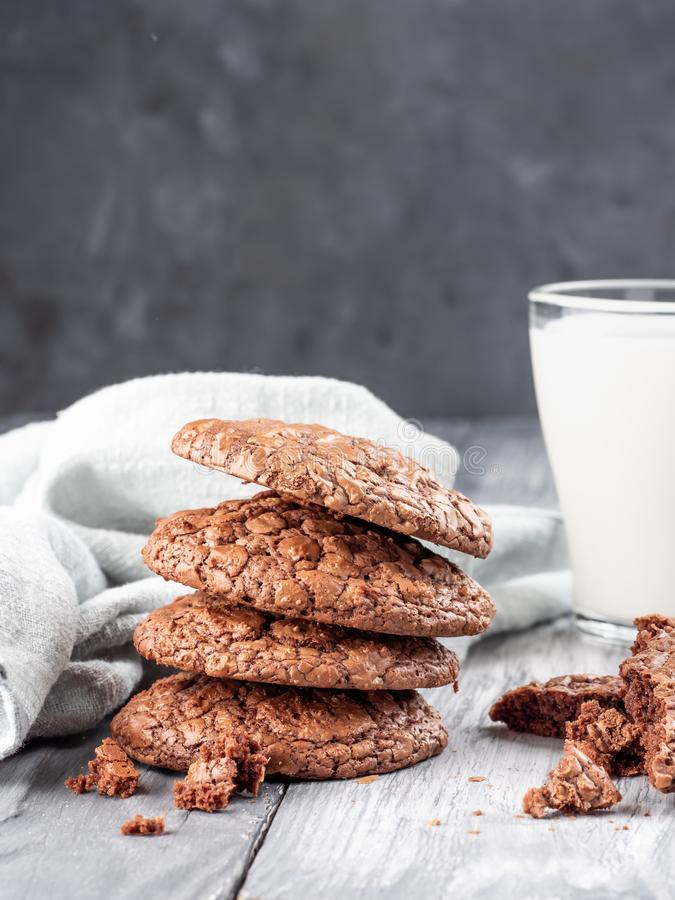 Brownie cookies on a wooden table with milk. Copy space stock image