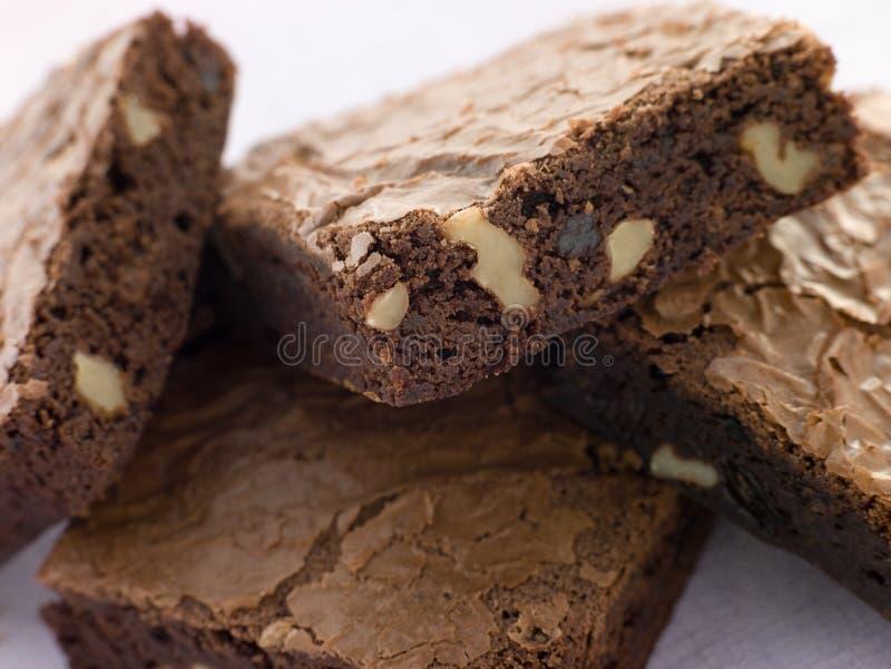 Brownie de la tuerca del chocolate imagenes de archivo
