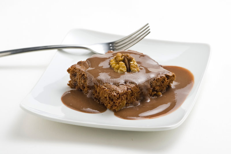 Brownie del cioccolato caldo con le noci e la vaniglia immagine stock
