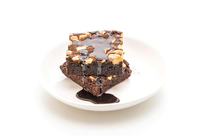 brownie del cioccolato con la salsa di cioccolato fotografia stock libera da diritti