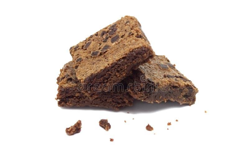 Brownie op witte achtergrond wordt ge?soleerd die stock afbeeldingen