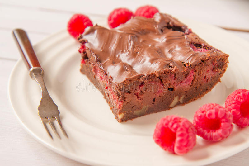 Brownie. With raspberries on a plate stock image