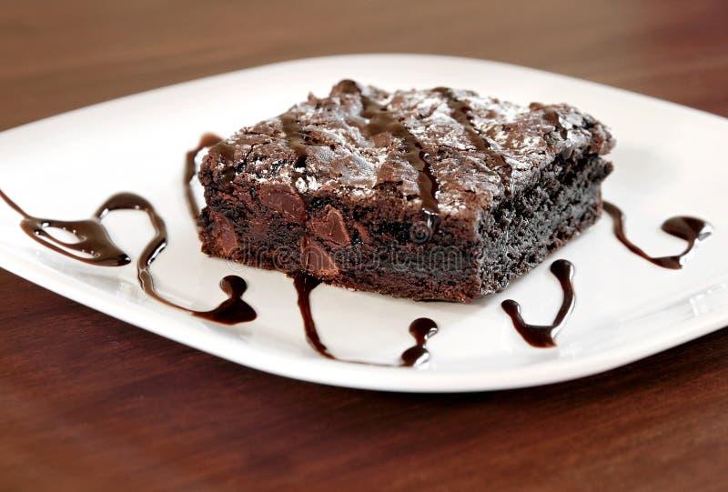 Brownie su una zolla fotografie stock
