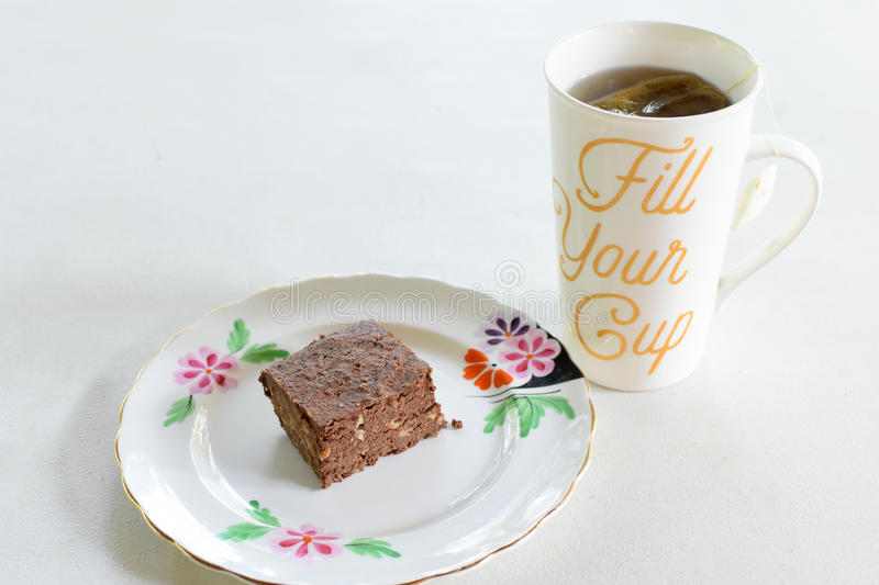 Brownie and Tea stock image