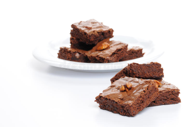Brownies. Fresh baked brownies shot on a white background royalty free stock images
