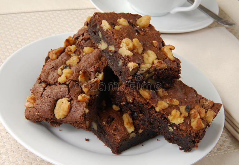 Brownies. With walnuts and a cup of tea stock photos