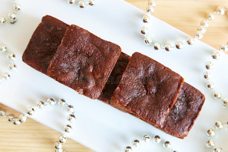 Brownies. Little soft chocolate brownies served in elegant style stock photos
