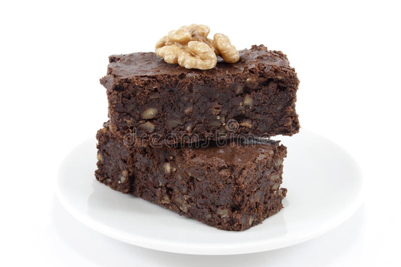 Brownies. Two brownies on white royalty free stock images