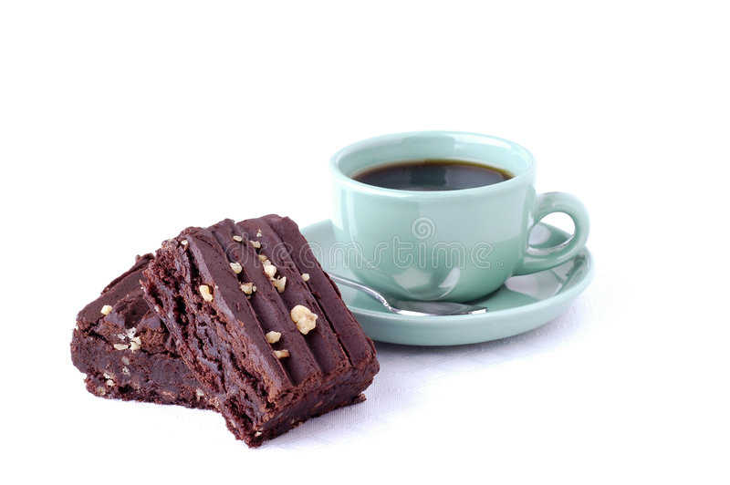 Brownies. Homemade brownies server with a cup of coffee royalty free stock photography