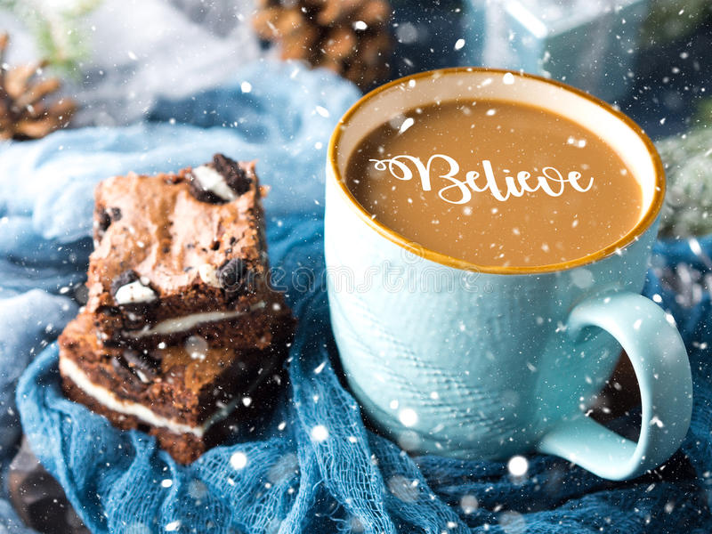 Brownies and coffee with falling dreamy snow royalty free stock photos