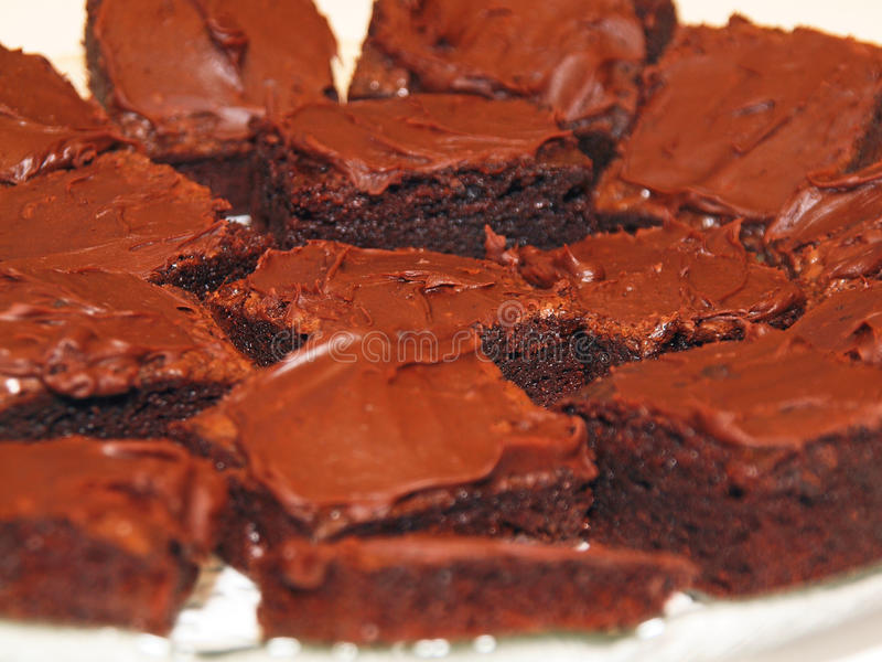 Brownies dessert. Homemade chocolate brownies on a plate, on a white background stock photo