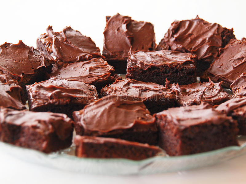 Brownies dessert. Homemade chocolate brownies on a plate, on a white background royalty free stock photos