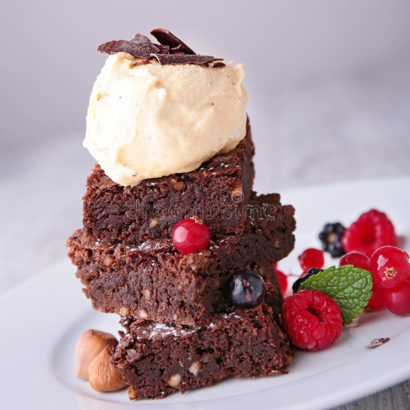 Brownies and icecream. With berries royalty free stock photography