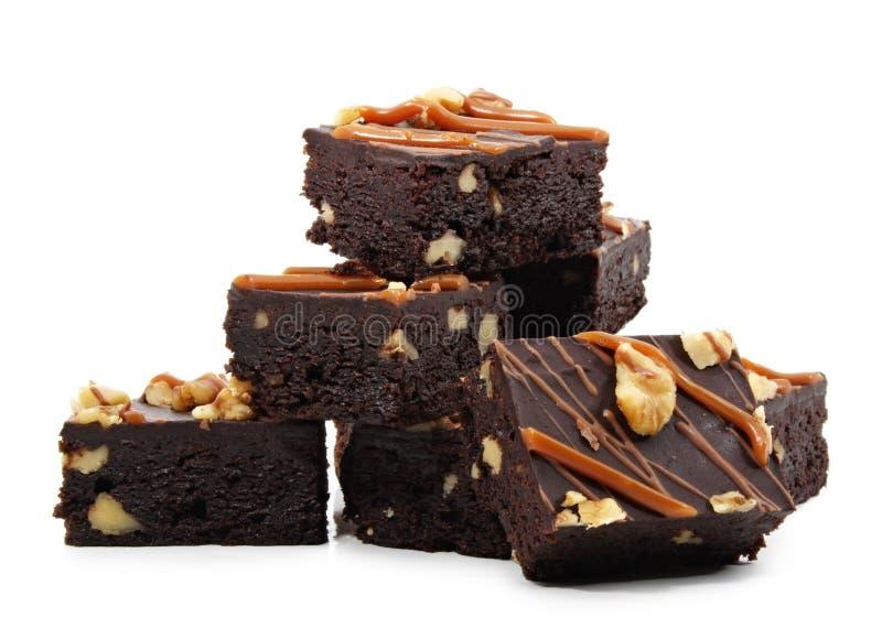 Brownies isoladas no branco imagens de stock royalty free
