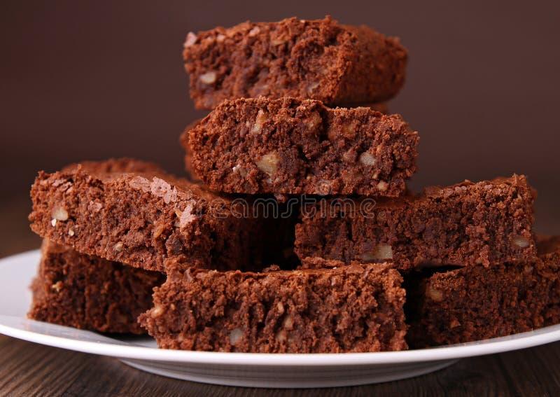 Brownies pile. Group of delicious brownies, studio shot stock image