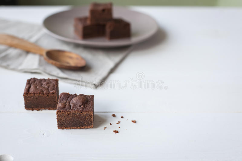 Brownies With a Wood Spoon. On the white table stock image