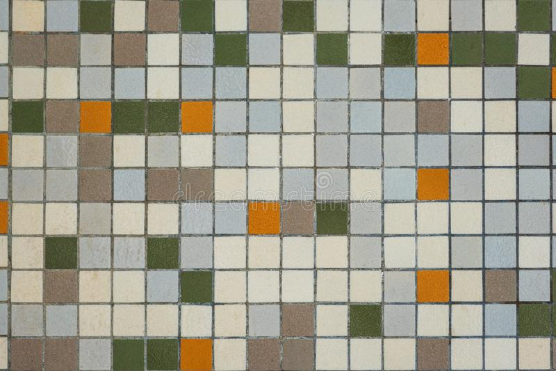 Brownish mozaic tiles in a bathroom pattern with brown, white , yellow and green tiles. Brownish mozaic tiles in a bathroom pattern with brown, white , yellow stock photos
