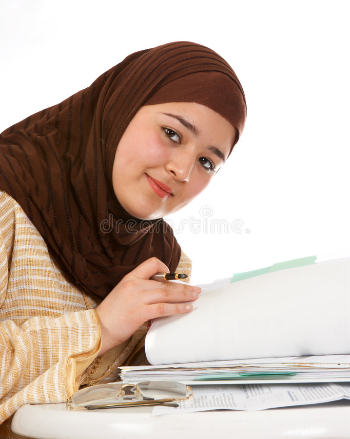 Browsing through files. Young islamic office worker browsing through her files